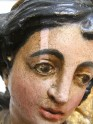 Immaculate Conception of Mary. Wooden polychrome sculpture. XVIII century. Poland. Close-up of the face during surface chemical cleaning test.